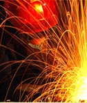 Welder working with gas torch.